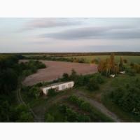 Продам здание тракторного стана, земля возле трассы 2, 7га С/г постройки